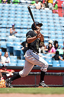 Omaha Storm Chasers outfielder Carlos Peguero (39) hits a home run during a game against the Nashville Sounds on May 20, 2014 at Herschel Greer Stadium in Nashville, Tennessee.  Omaha defeated Nashville 4-1.  (Mike Janes/Four Seam Images)