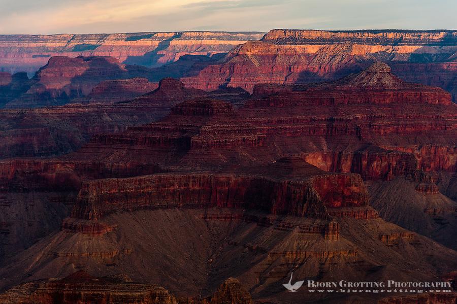 United States, Arizona, Grand Canyon. Sunrise at Yavapai Point. The morning sun colours everything red.