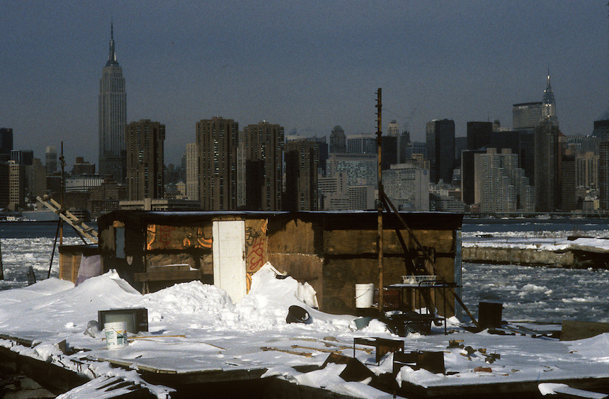 View of manhattan from a shanty hut on the Williamsburg Brooklyn side of the East River.  Williamsburg , Brooklyn, New York, Winter 1996