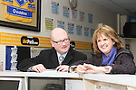Ged Nash checks his odds in Tully bookmakers while canvassing with Joan Burton in Wheaton Hall...(Photo credit should read Jenny Matthews www.newsfile.ie)....This Picture has been sent you under the conditions enclosed by:.Newsfile Ltd..The Studio,.Millmount Abbey,.Drogheda,.Co Meath..Ireland..Tel: +353(0)41-9871240.Fax: +353(0)41-9871260.GSM: +353(0)86-2500958.email: pictures@newsfile.ie.www.newsfile.ie.
