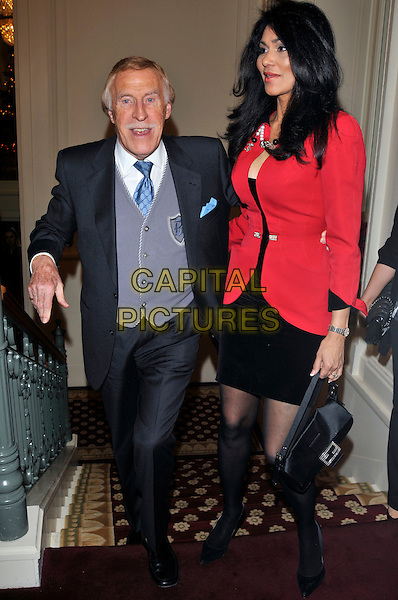 BRUCE FORSYTH & WILNELIA MERCED FORSYTH.attending the launch of 'Piers Morgan Tonight' on CNN at Mandarin Oriental Hyde Park, London, England, UK, December 7th, 2010..full length married couple husband wife red jacket suit tie blue grey gray waistcoat stairs climbing dress .CAP/PL.©Phil Loftus/Capital Pictures.