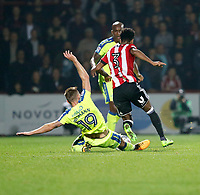 Andreas Weimann of Derby County attempts to tackle Rico Henry of Brentford during the Sky Bet Championship match between Brentford and Derby County at Griffin Park, London, England on 26 September 2017. Photo by Carlton Myrie / PRiME Media Images.