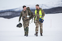 A British Merlin helicopter pilot and a ground crew member talk following a training mission in the Arctic, near Bardufoss, Norway. <br /> <br /> In 2019 the Arctic exercise Clockwork passed 50 years of training in Norway, and now has a permanent base within the Norwegian Air Force base at Bardufoss. <br /> <br /> 845 Naval Air Squadron is a squadron of the Royal Navy's Fleet Air Arm. Part of the Commando Helicopter Force, it is a specialist amphibious unit operating the Leonardo Commando Merlin Mk3 helicopter and provides troop transport and load lifting support to 3 Commando Brigade Royal Marines.<br /> <br /> ©Fredrik Naumann/Felix Features