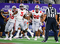 Ohio State Buckeyes defensive tackle Dre'Mont Jones (86) heads into the end zone for a 28-yard touchdown after intercepting a pass from TCU Horned Frogs quarterback Shawn Robinson, not pictured, during the third quarter of a NCAA Division I college football game between the TCU Horned Frogs and the Ohio State Buckeyes on Saturday, September 15, 2018 at AT&T Stadium in Arlington, Texas. [Joshua A. Bickel/Dispatch]