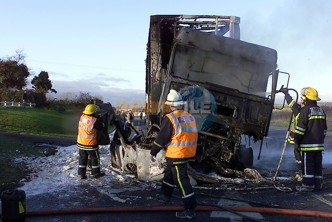The remains of the car that was carrying two locals is visable under the remains of the Truck.Crash outside Drogheda on the N1.Copy Elaine Keogh..Picture Fran Caffrey Newsfile.