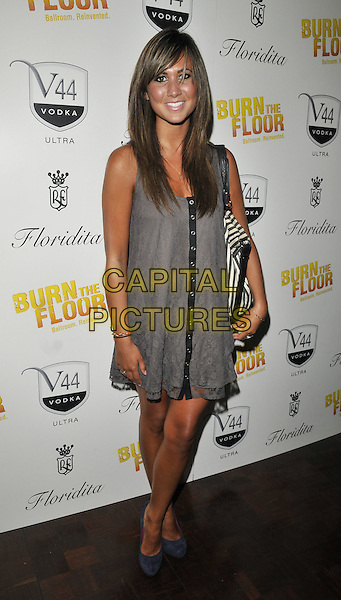 CIARA JANSON.'Burn  the Floor' Press Night at the Shaftesbury Theatre, London, England..July 26th 2010.full length grey gray dress blue shoes suede.CAP/CAN.©Can Nguyen/Capital Pictures.