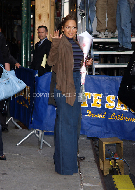 WWW.ACEPIXS.COM . . . . . ....NEW YORK, MAY 3, 2005....Jennifer Lopez arrives at a sceduled appearance on The Late Show with David Letterman, with just a glimpse of hubby Marc Anthony, amidst a PETA protest. PETA has actively pursued Jennifer Lopez since her Sweetface fashion show in February of 2005 which featured fur as essential part of the collection. In these pictures we see Jennifer Lopez arrive in a black strapless dress at the The Late Show studio. During her photo opportunity the male PETA activist tries to attack Jennifer Lopez and is apprehended by the police. The police then cart off the activist and his poster. Snoop Dogg, the musical guest for the same show, waits cautiously in his car for things to calm down and lightens the mood by playing with a gun pendant on his necklace. It's not until Snoop gets out of his car that you can see that Snoop Dogg is also wearing fur. Apparently he doesn't warrant his own PETA protest sign. After taping the show, sis Lynda Lopez makes her way out to see if the coast is clear. Shortly after Jennifer Lopez is seen exiting in jeans and casual wear. She waves and smiles for our camera but quickly heads to her car.....Please byline: KRISTIN CALLAHAN - ACE PICTURES.. . . . . . ..Ace Pictures, Inc:  ..Craig Ashby (212) 243-8787..e-mail: picturedesk@acepixs.com..web: http://www.acepixs.com