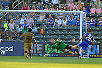Graham Zusi scores the second goal of the game pass goalkeeper Chris Seitz...Kansas City Wizards defeated Philadelphia Union 2-0, at Community America Ballpark, Kansas City, Kansas.