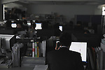 12:40 p.m., March 16, 2011, Tokyo, Japan - Workers at a company in Tokyo, Japan, work through lunch in a darkened office while conserving electricity in the face of ongoing power shortages due to the Tohoku-Kanto Natural Disaster. (Photo by Yosuke Tanaka/AFLO)