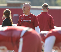 NWA Democrat-Gazette/ANDY SHUPE<br /> Arkansas assistant coach Chad Walker speaks to his players Tuesday, March 28, 2017, during spring practice at the UA practice facility in Fayetteville.