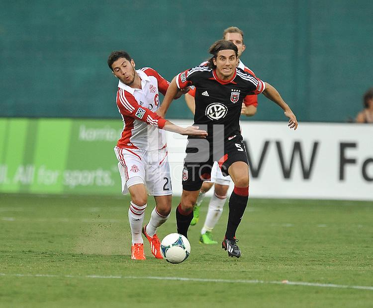 Dejan Jakovic (5) of D.C. United goes against Jonathan Osorio (21) of Toronto FC. Toronto FC tied D.C. United 1-1, at RFK Stadium, Saturday August 24 , 2013.