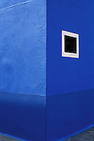 Italy, Island of Burano. Detail of blue wall. One of the Islands near Venice