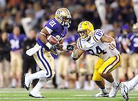 Sept. 5, 2009; Seattle, WA, USA; LSU Tigers defensive end (84) Rahim Alem chases Washington Huskies tailback (21) Willie Griffin at Husky Stadium. LSU defeated Washington 31-23. Mandatory Credit: Mark J. Rebilas-