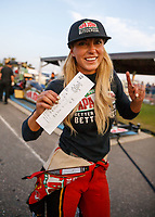 Aug 18, 2017; Brainerd, MN, USA; NHRA top fuel driver Leah Pritchett celebrates with her time slip after setting a new national record time of 3.640 during qualifying for the Lucas Oil Nationals at Brainerd International Raceway. Mandatory Credit: Mark J. Rebilas-USA TODAY Sports