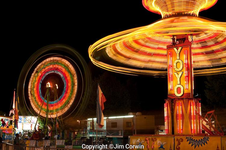 Evergreen State Fair people enjoying the amusement rides and game booths at night Monroe Washington State USA