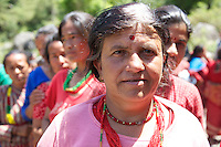 Parvati, a Nepalese woman whose home was partially destroyed in the earthquake on 25 April, waits in line for a UK aid shelter kit at a distribution organised by the NGO Medair.<br /> <br /> Picture: Russell Watkins/Department for International Development