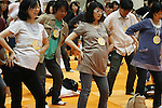 May 8, 2010 - Tokyo, Japan - Pregnant mothers and mens participate in an exercise workshop during the Maternity & Baby Festa 2010 show at Tokyo Big Sight, Japan, on May 8, 2010. Nearly 20,000 people are expected to attend the two-days annual event which features this season's maternity fashions, kids gear, pregnancy information sessions, maternity and exercise workshops for new mothers.