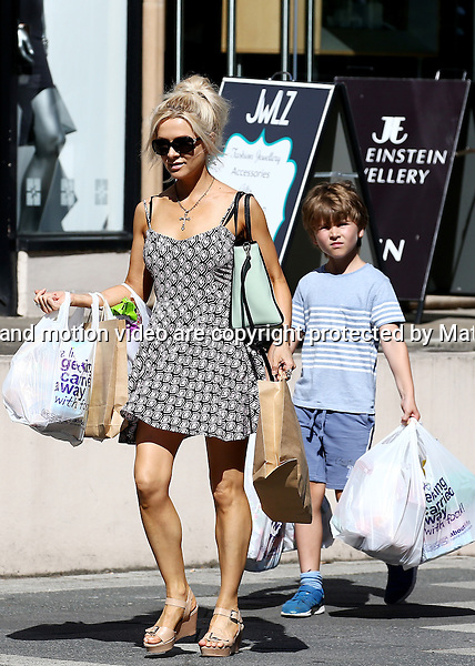 15 DECEMBER 2014 SYDNEY AUSTRALIA<br /> <br /> EXCLUSIVE <br /> <br /> A toned Danielle Spencer-Crowe dressed in a light summer dress pictured making a dash back to her car with some groceries and shopping in Double Bay. Young Tennyson was also on hand to help his mum with some heavy bags. <br /> <br /> *No web use without clearance*.<br /> MUST CONTACT PRIOR TO USE <br /> +61 2 9211-1088. <br /> <br /> Matrix Media Group.Note: All editorial images subject to the following: For editorial use only. Additional clearance required for commercial, wireless, internet or promotional use.Images may not be altered or modified. Matrix Media Group makes no representations or warranties regarding names, trademarks or logos appearing in the images.