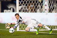 Philadelphia Union goalkeeper Zac MacMath (18) dives for a ball during the first half against the Chicago Fire during a Major League Soccer (MLS) match at PPL Park in Chester, PA, on May 18, 2013.