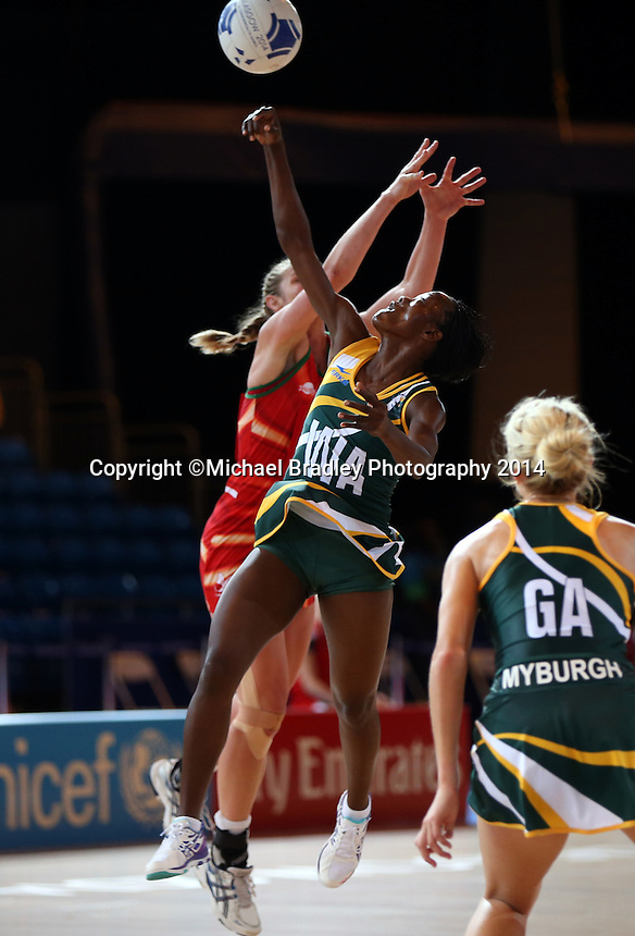 29.07.2014 South Africa's Zanele Mdodana in action during the South v Wales netball match at the Commonwealth Games Glasgow Scotland on the 29th of July 2014. Mandatory Photo Credit ©Michael Bradley.