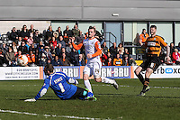 Jack Marriott of Luton Town (2nd left) beats Graham Stack of Barnet (left) only to see his effort ruled out for off-side during the Sky Bet League 2 match between Barnet and Luton Town at The Hive, London, England on 28 March 2016. Photo by David Horn.