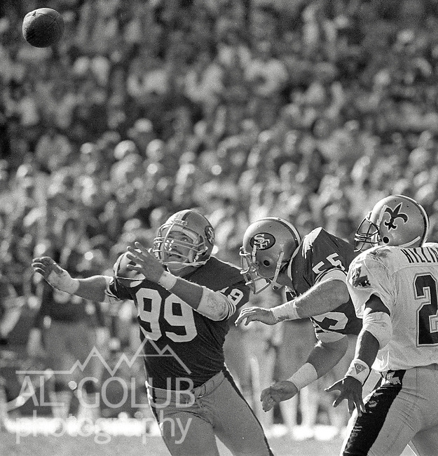 San Francisco 49ers vs New Orleans Saints  at Candlestick Park Sunday, November 15, 1987.. Saints beat 49ers 26-24.San Francisco 49ers Linebacker Mike Walter (99) goes after loose ball..