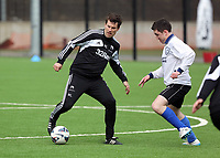Thursday 11 April 2013<br /> Pictured L-R: Michael Laudrup against Chris Wathan of Media Wales.<br /> Re: Friendly game, Swansea City FC coaching staff v sports reporters at the Swansea City FC training ground. Final score 10-4.