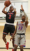 Savion Lewis #3 of Half Hollow Hills East, left, pulls up for a jumper as Gary Grant of St. Raymond (Bronx) guards him during a non-league varsity boys basketball game in the Gary Charles Hoop Classic at Adelphi University on Sunday, Jan. 7, 2018. St. Raymond defeated Hills East by a score of 82-72.