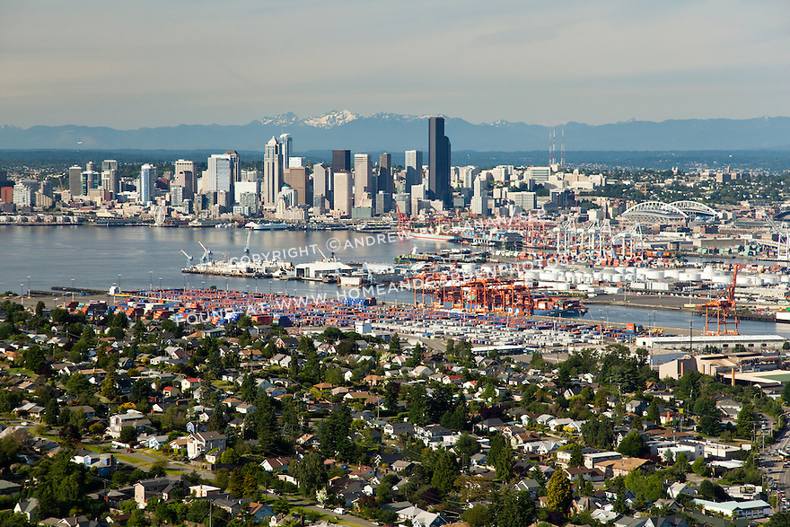 West Seattle neighborhoods and the Port of Seattle on of Elliott Bay with downtown Seattle skyline behind; Seattle, WA