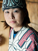 An Ainu woman playing a Tonkori in the Ainu Museum. The Ainu people are indigenous to Japan and Russia. Lake Poroto, Hokkaid?, Japan