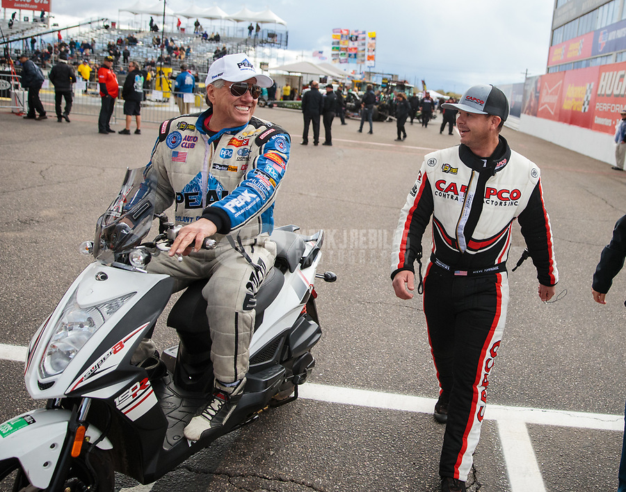 Feb 22, 2019; Chandler, AZ, USA; NHRA funny car driver John Force (left) talks with top fuel driver Steve Torrence during qualifying for the Arizona Nationals at Wild Horse Pass Motorsports Park. Mandatory Credit: Mark J. Rebilas-USA TODAY Sports