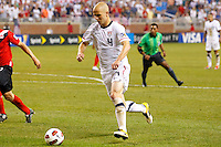 7 June 2011: USA Men's National Team midfielder Michael Bradley (4) dribbles the ball during the CONCACAF soccer match between USA and Canada at Ford Field Detroit, Michigan. USA won 2-0.