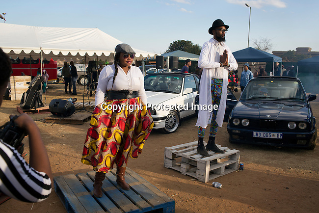 SOWETO, SOUTH AFRICA JULY 6: Models show clothes during a fashion show at an outdoor market on July 6, 2014 in Orlando West section of Soweto, South Africa. Soweto today is a mix of old housing and newly constructed townhouses. A new hungry black middle-class is growing steadily. Many residents work in Johannesburg but the last years many shopping malls have been built, and people are starting to spend their money in Soweto. (Photo by: Per-Anders Pettersson)