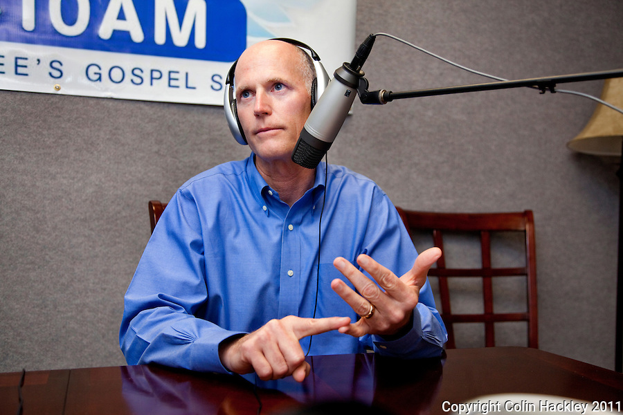 TALLAHASSEE, FLA. 7/28/11-SCOTTRADIO HACKLEY02-Gov. Rick Scott responds to questions from radio talk show host Jay Green during Green's show on gospel radio station WHBT 1410 AM, Thursday in Tallahassee. Recently Scott has been appearing on talk radio across the state several times a day as a way to get his message out to Floridians..COLIN HACKLEY PHOTO