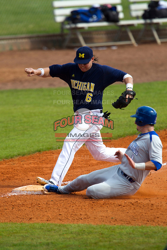 Michigan Wolverines third baseman John Lorenz #6 attempts to get out Will Walsh #1 sliding in during a game against the Seton Hall Pirates at the Big Ten/Big East Challenge at Al Lang Stadium on February 18, 2012 in St. Petersburg, Florida.  (Mike Janes/Four Seam Images)