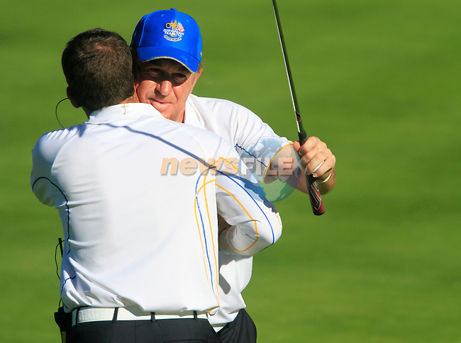 Miguel Angel Jiminez hugs Sergio Garcia after winning Match 7 beating Bubba Watson at the 15th green during Match 7 of the Singles Matches during the Final Day of the The 2010 Ryder Cup at the Celtic Manor, Newport, Wales, 3rd October 2010..(Picture Eoin Clarke/www.golffile.ie)