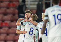 Winning goalscorer Jack Stephens (left) (Southampton) of England celebrates with James Ward-Prowse (Southampton) of England during the Under 21 International Friendly match between England and Italy at St Mary's Stadium, Southampton, England on 10 November 2016. Photo by Andy Rowland.