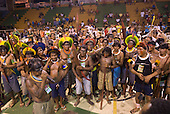 """Altamira, Brazil. """"Xingu Vivo Para Sempre"""" protest meeting about the proposed Belo Monte hydroeletric dam and other dams on the Xingu river and its tributaries. Mokuka fom Moikarako leads the warriors in the National Anthem of Brazil in Kayapo."""