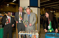 March 19 2003, Montreal, Quebec, Canada<br /> <br /> (fron Left to Right)<br />  Alan  De Sousa, City of Montreal delegate for sustainable Development<br /> David Anderson,Canada's  Environment Minister,, Andre Caille, President and CEO of Hydro Quebec and Honorary President of AMERICANA 2003,join the SCRAP BAND  to celebrate the opening  of Americana, a 3 days  trade show on environement and waste management organized by Reseau Environnement, March 19, 2003 in Montreal, Canada.<br /> <br /> Mandatory Credit: Photo by Pierre Roussel- Images Distribution. (&copy;) Copyright 2003 by Pierre Roussel <br /> <br /> NOTE : <br />  Nikon D-1 jpeg opened with Qimage icc profile, saved in Adobe 1998 RGB<br /> .Uncompressed  Original  size  file availble on request.