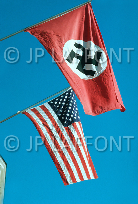 February 10, 1972, Arlington, Virginia. In front of the White National Socialist Party the american flag is shown along with the swastica flag.