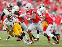 Ohio State Buckeyes wide receiver Philly Brown (10) looks for running room against Iowa Hawkeyes linebacker James Morris (44) during a punt return in the third quarter at Ohio Stadium on October 19, 2013.  (Chris Russell/Dispatch Photo)