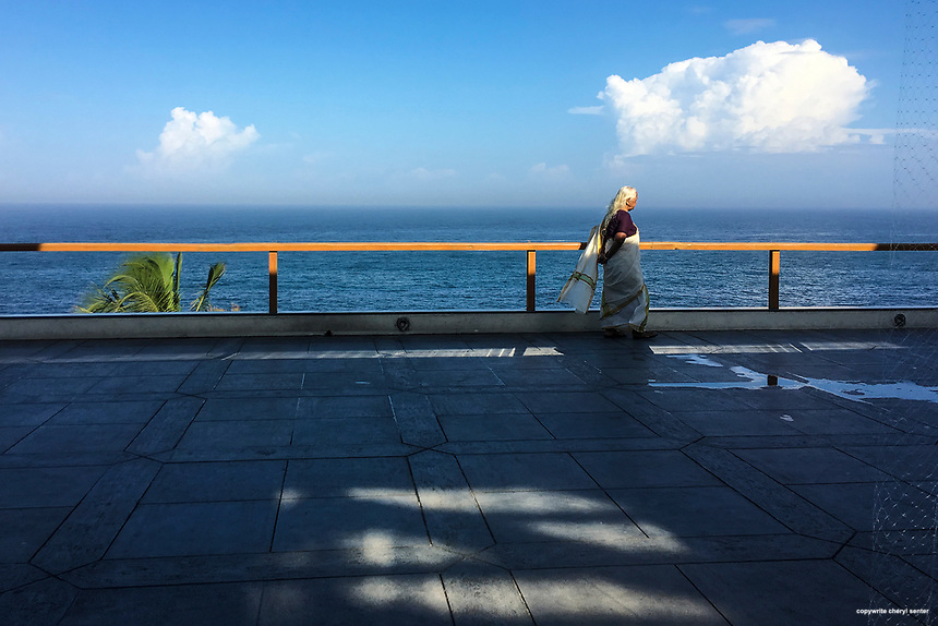 A woman enjoys the spectacular view of the Indian Ocean at an outdoor cafe in Thiruvananthapuram, Kerala, India  June 16, 2017 (Cellphone Photo by Cheryl Senter)