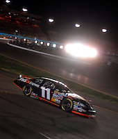 Apr 22, 2006; Phoenix, AZ, USA; Nascar Nextel Cup driver Denny Hamlin of the (11) Fed Ex Express Chevrolet Monte Carlo during the Subway Fresh 500 at Phoenix International Raceway. Mandatory Credit: Mark J. Rebilas-US PRESSWIRE Copyright © 2006 Mark J. Rebilas..