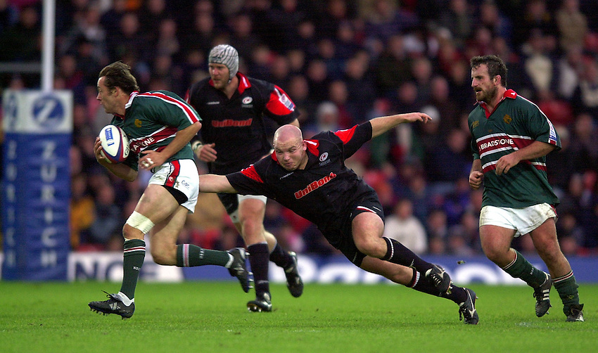 Photo. Richard Lane. .Saracens v Leicester Tigers. Zurich Premiership. 27-10-2002.Matt Cairns gets a tackle in on Jamie Hamilton.