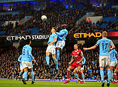 9th January 2018, Etihad Stadium, Manchester, England; Carabao Cup football, semi-final, 1st leg, Manchester City versus Bristol City; Eliaquim Mangala and John Stones of Manchester City go up to head the ball clear