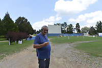 The Kings Drive In movie in Russelville Alabama Jimmy Greenhill owner and his grandson Weston Gregory Greenhill,5 yrs old, get ready for the Saturday Drive In Friday July 12,2013. <br /> Artist Eugenia Summer at home Saturday July 13,2013,Columbus MS.&copy; Suzi Altman/TheOneMediaGroup