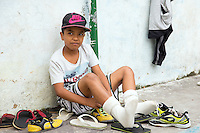 A kid at a small football pitch in Favela Santo Amaro in the hills around Rio de Janeiro