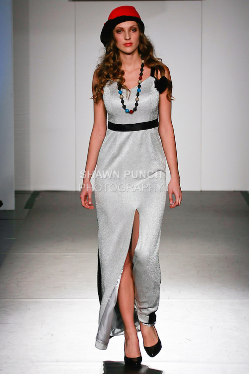 Model walks runway in an outfit from the Baruni Fall 2012 collection, by Fadwa Baruni, during Nolcha Fashion Week: New York City Fall 2012.