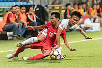 SINGAPORE, SINGAPORE - AUGUST 31: Tsui Wang Kit of Hong Kong (R) fights for the ball with Nazrul Nazari of Singapore (L) during the international friendly match between Singapore and Hong Kong at the Jalan Besar Stadium on August 31, 2017, in Singapore, Singapore. (Photo by Getty Images)