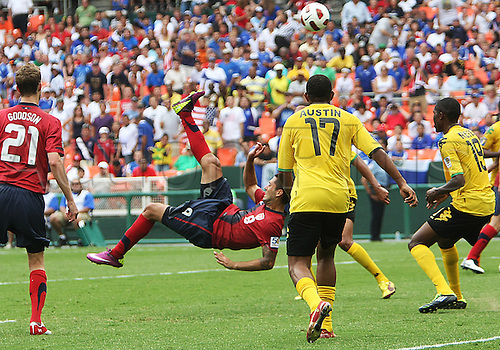 19.06.2011. Washington, USA.  Clint Dempsey (8) of  USA kicks the ball over Adrian Reid (19) of Jamaica during a CONCACAF Gold Cup quarter-final match at RFK stadium in Washington D.C. USA won 2-0.
